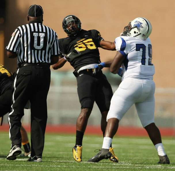 Dekaney's Jared Marshall (79) shoves Klein Oak's Javon Shelley during the first half of a high schoo