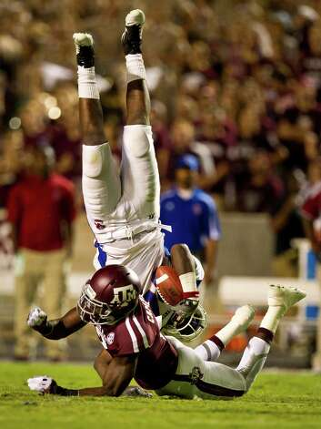 Texas A&M University defensive back Steven Campbell (2) upends South Carolina State University tight end Dwight Brannon (84) on a pass in the flat during the fourth quarter of a NCAA football game, Saturday, Sept. 22, 2012, in College Station. Photo: Nick De La Torre, Houston Chronicle / © 2012 Houston Chronicle