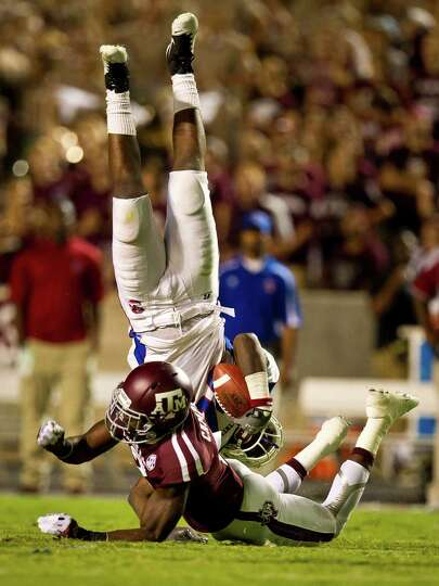 Texas A&M University defensive back Steven Campbell (2) upends South Carolina State University tight