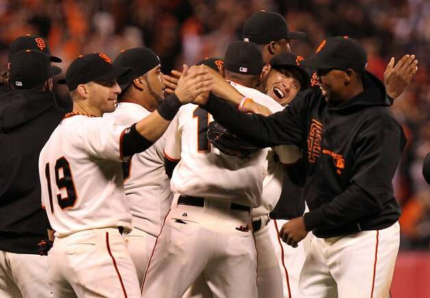 The Giants, including Marco Scutaro (19) shaking hands with Francisco Peguero, celebrate their National League West division title after defeating the Padres. Photo: Lance Iversen, The Chronicle / SF