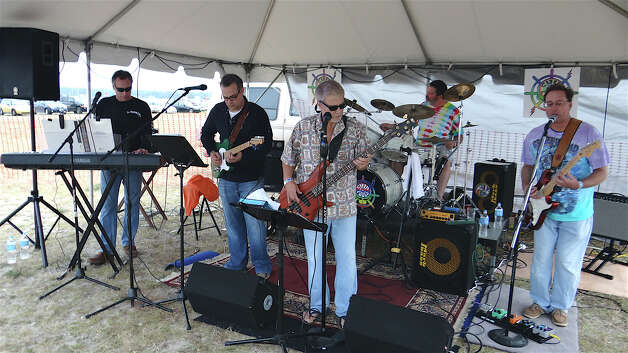 The band, Ship of Fools, entertains the crowd at the Westport Rotary Club's Lobster Fest on Saturday at Compo Beach. Photo: Mike Lauterborn / Westport News contributed
