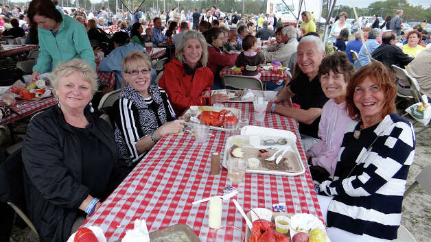 Enjoying the Westport Rotary's Lobster Fest were Jean Tighe, Deborah Schneider, Stephanie Rasmussen, Bob Schneider, Kathleen Walsh and Rhona Lieberson, who were among the large crowd Saturday at Compo Beach. Photo: Mike Lauterborn / Westport News contributed