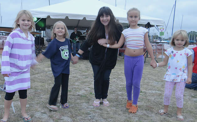 An impromptu dance was shared Saturday at the Lobster Fest on Compo Beach by young Emmah Tait, Lila Osmun, Christina Iannucci, Hayley Osmun and Chloe Tait. Photo: Mike Lauterborn / Westport News contributed