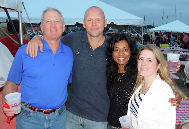 Bob Jones, Westport Police Officer Scott Morrison, Sabita Holistic Wellness Center's Sabita Kanhai and Jackie Jones at the Westport Rotary Club's Lobster Fest on Saturday. Photo: Mike Lauterborn / Westport News contributed