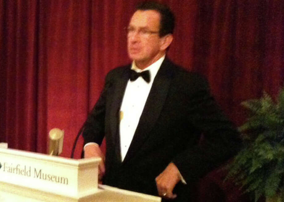 Gov. Dannel Malloy addresses the opening night recpetion for the new 'Promise of Freedom' exhibit at the Fairfield Museum and History Center on Saturday. Photo: Andrew Brophy / Fairfield Citizen contributed