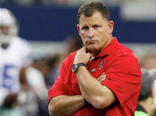 Tampa Bay Buccaneers head coach Greg Schiano watches his team warm up before an NFL football game against the Dallas Cowboys, Sunday, Sept. 23, 2012, in Arlington, Texas. (AP Photo/LM Otero) Photo: LM Otero, Associated Press / AP