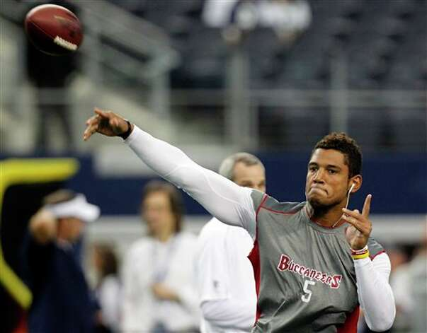 Tampa Bay Buccaneers quarterback Josh Freeman (5) warms up before a game against the Dallas Cowboys before an NFL football game, Sunday, Sept. 23, 2012 in Arlington, Texas. (AP Photo/LM Otero) Photo: LM Otero, Associated Press / AP