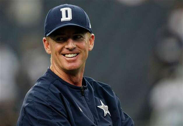 Dallas Cowboys head coach Jason Garrett watches the team warm up before an NFL football game against the Tampa Bay Buccaneers, Sunday, Sept. 23, 2012 in Arlington, Texas. (AP Photo/LM Otero) Photo: LM Otero, Associated Press / AP