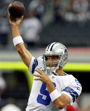 Dallas Cowboys quarterback Tony Romo (9) warms up before an NFL football game against the Tampa Bay Buccaneers, Sunday, Sept. 23, 2012 in Arlington, Texas. (AP Photo/LM Otero) Photo: LM Otero, Associated Press / AP