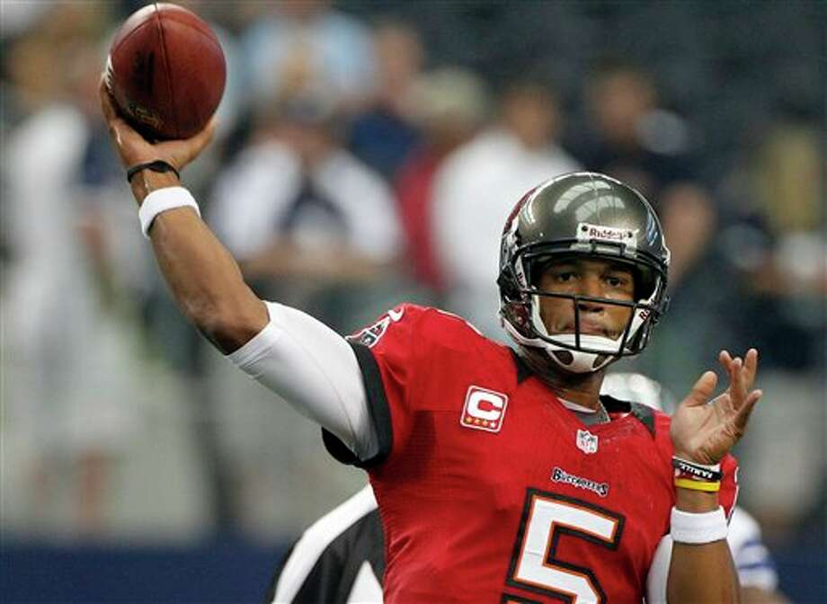 Tampa Bay Buccaneers quarterback Josh Freeman (5) warms up before an NFL football game against the Dallas Cowboys, Sunday, Sept. 23, 2012 in Arlington, Texas. (AP Photo/Tony Gutierrez) Photo: Tony Gutierrez, Associated Press / AP