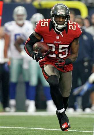 Tampa Bay Buccaneers cornerback Aqib Talib (25) runs with the ball intercepting a pass by Dallas Cowboys quarterback Tony Romo away during the first half of an NFL football game, Sunday, Sept. 23, 2012 in Arlington, Texas. (AP Photo/LM Otero) Photo: LM Otero, Associated Press / AP