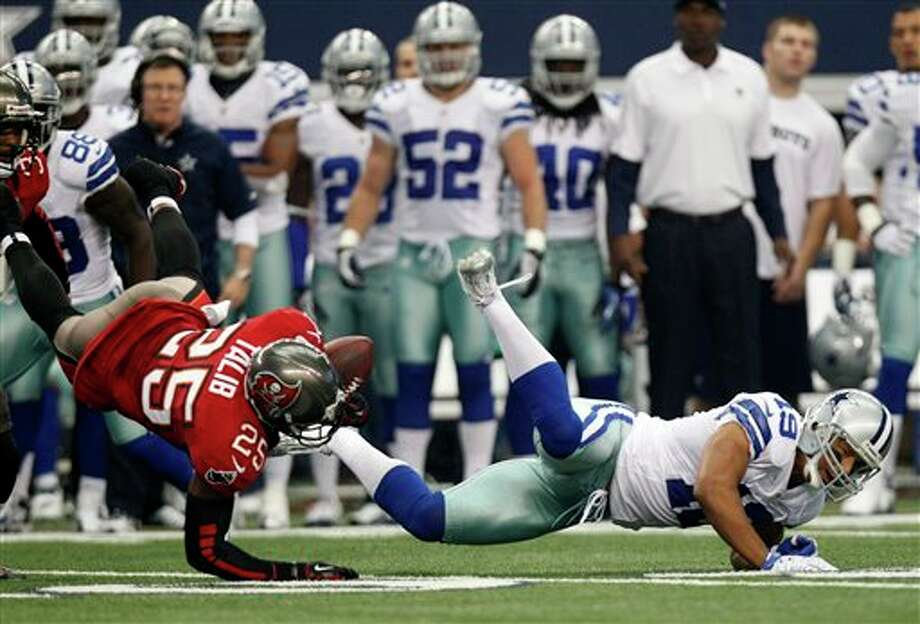 Tampa Bay Buccaneers cornerback Aqib Talib (25) intercepts a pass by Dallas Cowboys quarterback Tony Romo as wide receiver Miles Austin (19) falls away during the first half of an NFL football game on Sunday, Sept. 23, 2012, in Arlington, Texas. (AP Photo/LM Otero) Photo: LM Otero, Associated Press / AP