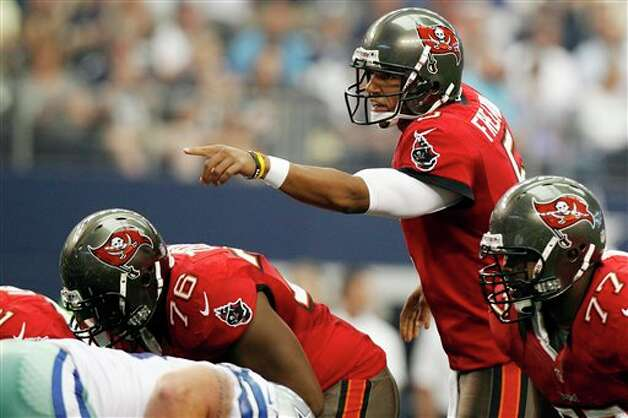 Tampa Bay Buccaneers quarterback Josh Freeman (5) calls a play against the Dallas Cowboys during the first half of an NFL football game, Sunday, Sept. 23, 2012, in Arlington, Texas. (AP Photo/LM Otero) Photo: LM Otero, Associated Press / AP