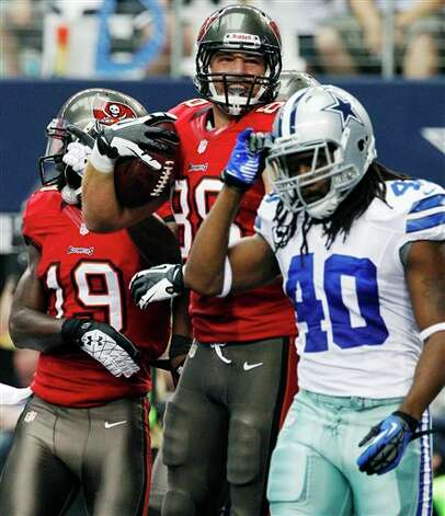Tampa Bay Buccaneers tight end Luke Stocker (88) and Mike Williams (19) celebrate a touchdown as Dallas Cowboys defensive back Danny McCray (40) walks away during the first half of an NFL football game, Sunday, Sept. 23, 2012, in Arlington, Texas. (AP Photo/Tony Gutierrez) Photo: Tony Gutierrez, Associated Press / AP