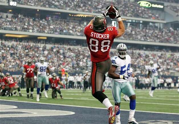 Tampa Bay Buccaneers tight end Luke Stocker (88) makes a touchdown reception as Dallas Cowboys inside linebacker Bruce Carter moves during the first half of an NFL football game, Sunday, Sept. 23, 2012 in Arlington, Texas. (AP Photo/LM Otero) Photo: LM Otero, Associated Press / AP