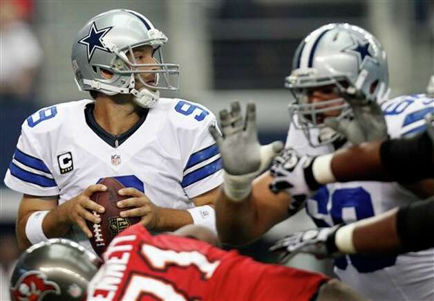 Dallas Cowboys quarterback Tony Romo (9) passes the ball against the Tampa Bay Buccaneers during the first half of an NFL football game on Sunday, Sept. 23, 2012, in Arlington, Texas. (AP Photo/LM Otero) Photo: LM Otero, Associated Press / AP