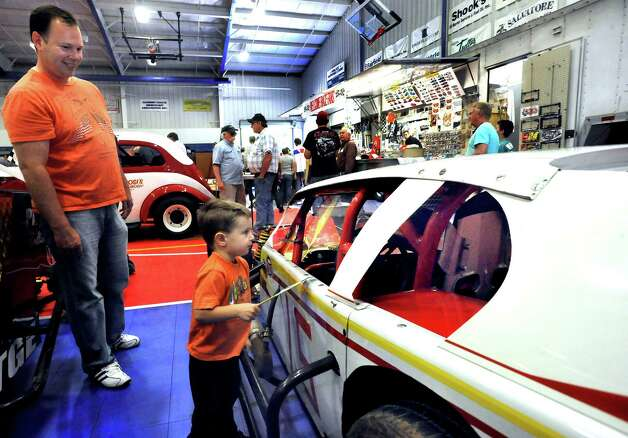 John Landry and his son, Ryan, 3, of Danbury, enjoy the cars on display at the Southern New York Racing Association reunion of the drivers and fans from the Racearena, which is now the Danbury Fair mall Sunday, Sept. 23, 2012. Photo: Michael Duffy