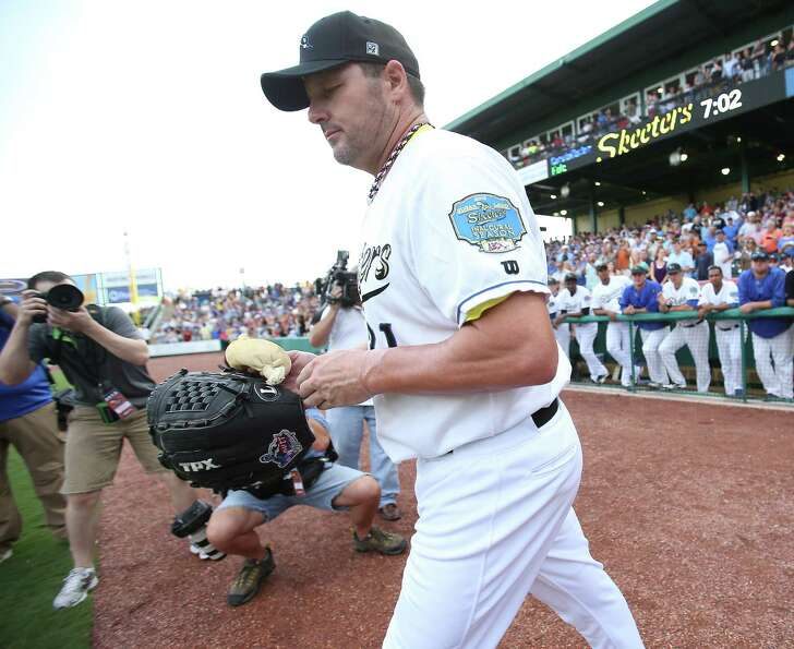 Roger Clemens goes out onto the field before his start.