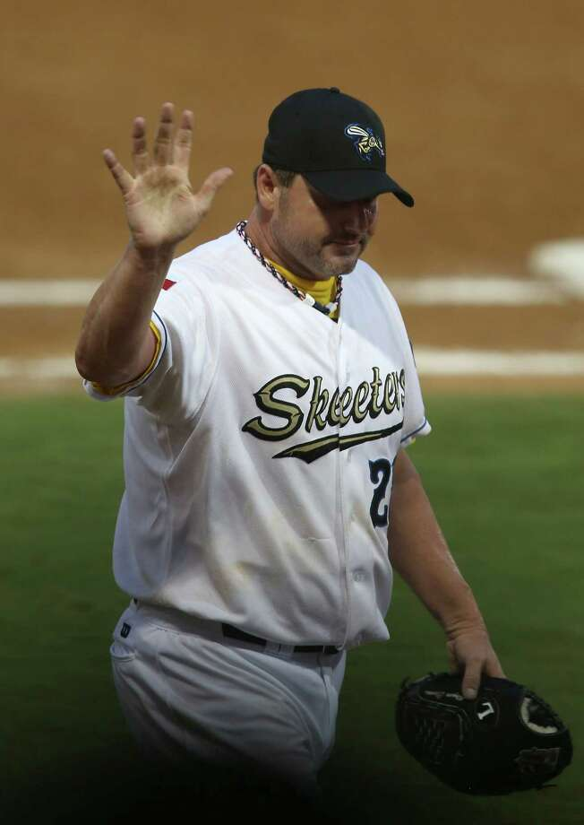 Roger Clemens waves to the crowd as he walks back to the dugout after getting relieved  in the fourth inning. Photo: Karen Warren / © 2012  Houston Chronicle