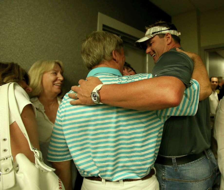 Roger Clemens hugs his attorney Rusty Hardin after speaking to the media. Photo: Karen Warren / © 2012  Houston Chronicle