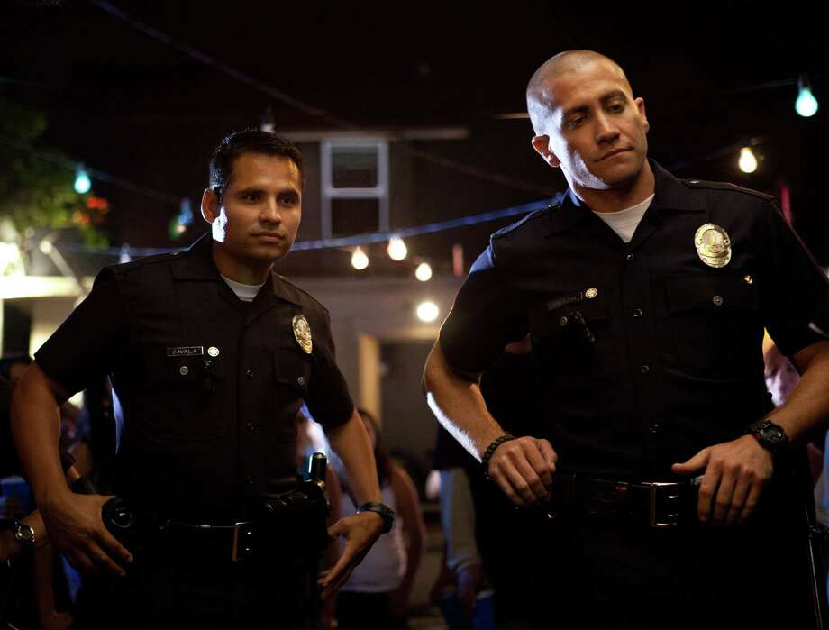 """This film image released by Open Road Films shows Michael Pena, left, and Jake Gyllenhaal in a scene from """"End of Watch."""" (AP Photo/Open Road Films, Scott Garfield) Photo: Scott Garfield"""