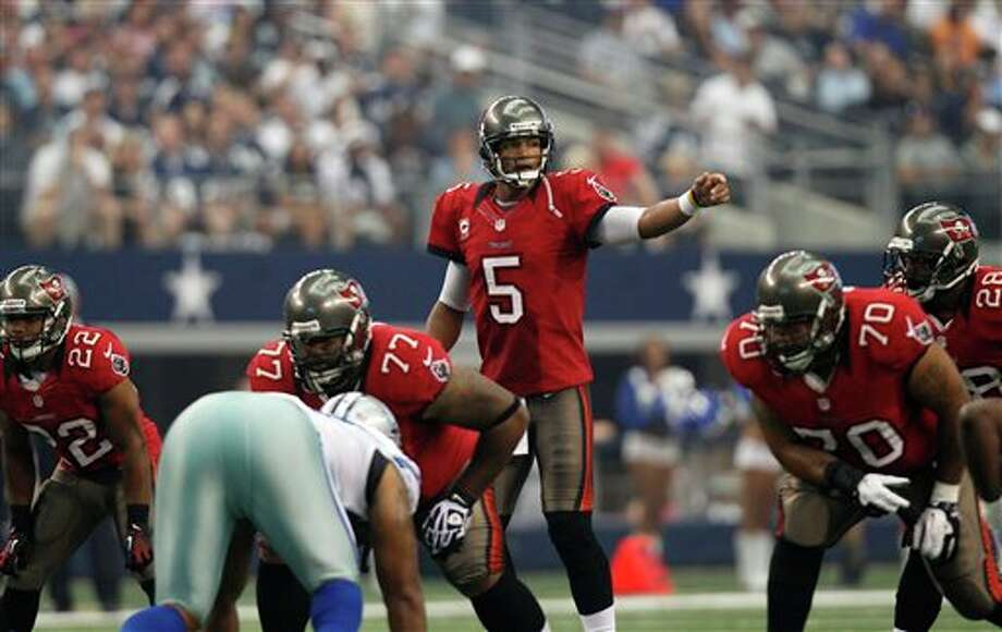 Tampa Bay Buccaneers' Josh Freeman (5) signals at the line of scrimmage against the Dallas Cowboys in an NFL football game Sunday, Sept. 23, 2012, in Arlington, Texas. (AP Photo/LM Otero) Photo: Associated Press