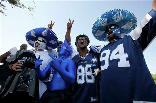 Dallas Cowboys fans tailgate before an NFL football game against the Tampa Bay Buccaneers Sunday, Sept. 23, 2012, in Arlington, Texas. (AP Photo/Tim Sharp) Photo: Tim Sharp