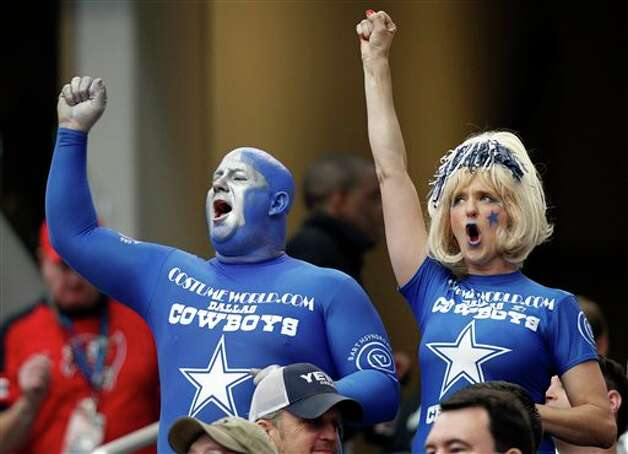 Dallas Cowboys fans cheer the team during the first half of an NFL football game against the Tampa Bay Buccaneers, Sunday, Sept. 23, 2012, in Arlington, Texas. (AP Photo/LM Otero) Photo: Associated Press