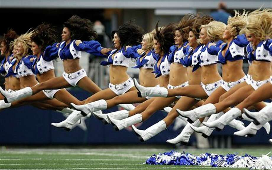 Members of the Dallas Cowboys cheerleaders perform during an NFL football game against the Tampa Bay Buccaneers  Sunday, Sept. 23, 2012, in Arlington, Texas. (AP Photo/LM Otero) Photo: Associated Press