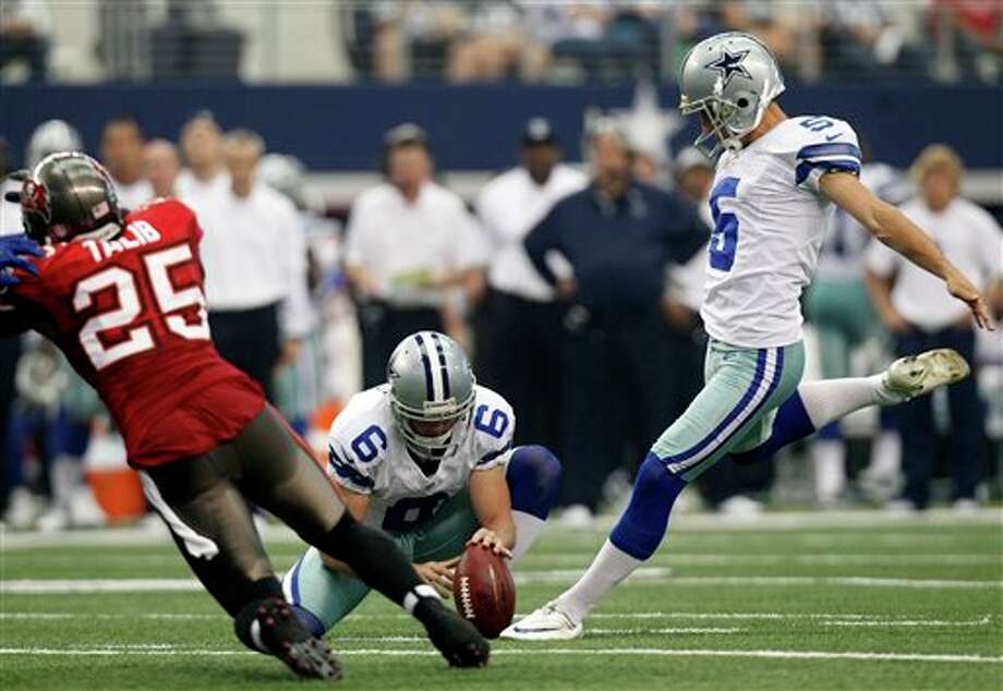 Dallas Cowboys kicker Dan Bailey (5) boots a field goal as Chris Jones (6) holds against the Tampa Bay Buccaneers during the first half of an NFL football game on, Sunday, Sept. 23, 2012, in Arlington, Texas. (AP Photo/LM Otero) Photo: Associated Press