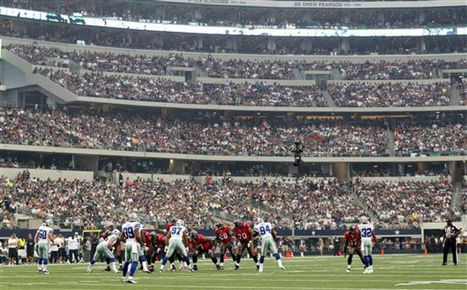 The Tampa Bay Buccaneers and Dallas Cowboys during an NFL football game Sunday, Sept. 23, 2012, in Arlington, Texas. (AP Photo/LM Otero) Photo: Associated Press