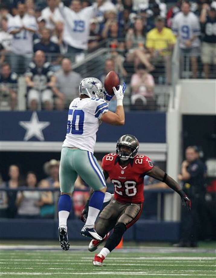 Dallas Cowboys' Sean Lee (50) grabs an interception as Tampa Bay Buccaneers' D.J. Ware (28) watches in the first half of an NFL football game Sunday, Sept. 23, 2012, in Arlington, Texas. (AP Photo/LM Otero) Photo: Associated Press