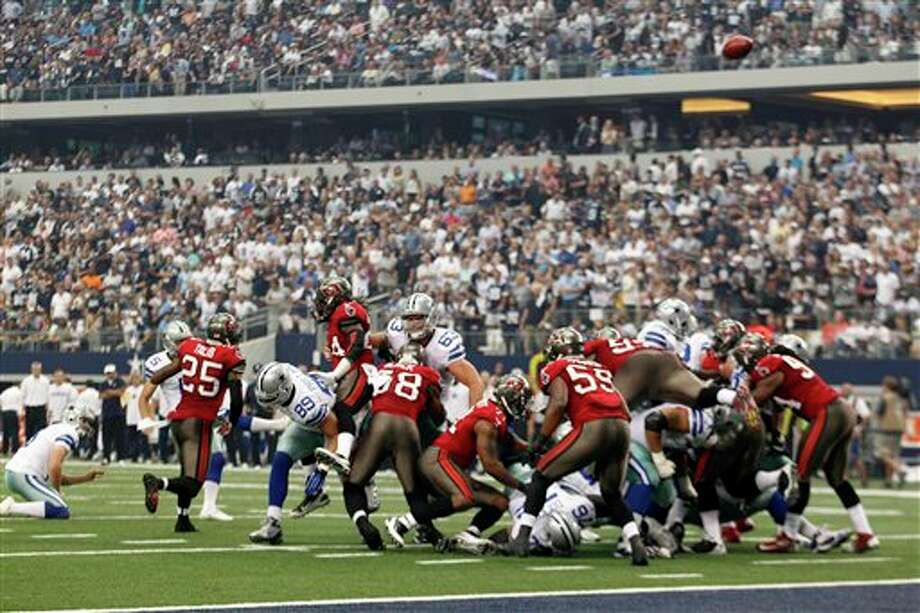 The Tampa Bay Buccaneers kick an extra point in the first half of an NFL football game against the Dallas Cowboys Sunday, Sept. 23, 2012, in Arlington, Texas. (AP Photo/LM Otero) Photo: Associated Press