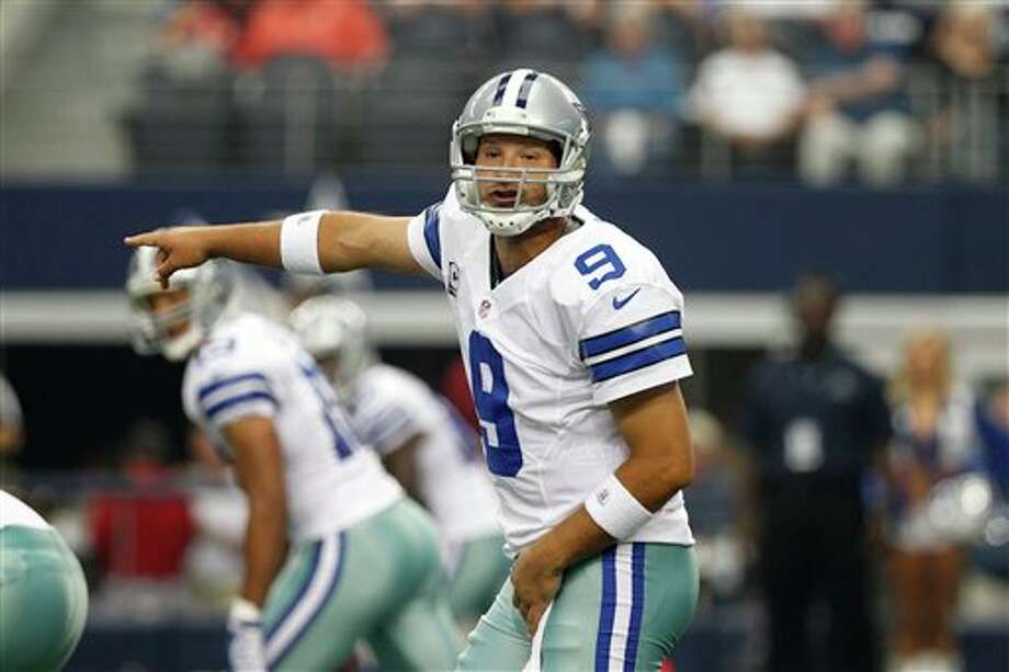 Dallas Cowboys' Tony Romo (9) signals at the line of scrimmage against the Tampa Bay Buccaneers in the first half of an NFL football game Sunday, Sept. 23, 2012, in Arlington, Texas. (AP Photo/Tony Gutierrez) Photo: Associated Press