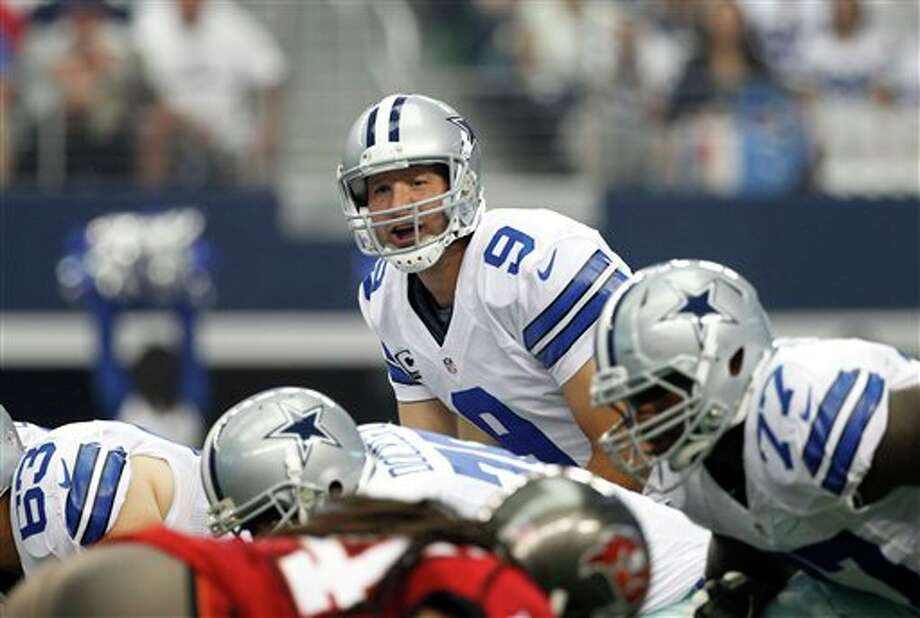Dallas Cowboys quarterback Tony Romo (9) makes a call at the line of scrimmage against the Tampa Bay Buccaneers in the first half of an NFL football game Sunday, Sept. 23, 2012, in Arlington, Texas. (AP Photo/Tony Gutierrez) Photo: Associated Press