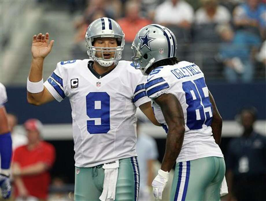 Dallas Cowboys' Tony Romo (9) instructs Kevin Ogletree (85) at the line of scrimmage in the first half of an NFL football game against the Tampa Bay Buccaneers Sunday, Sept. 23, 2012, in Arlington, Texas. (AP Photo/Tony Gutierrez) Photo: Associated Press