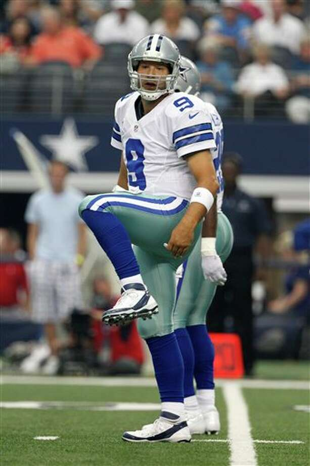 Dallas Cowboys' Tony Romo (9) signals at the line of scrimmage in the first half of an NFL football game against the Tampa Bay Buccaneers Sunday, Sept. 23, 2012, in Arlington, Texas. (AP Photo/Tony Gutierrez) Photo: Associated Press