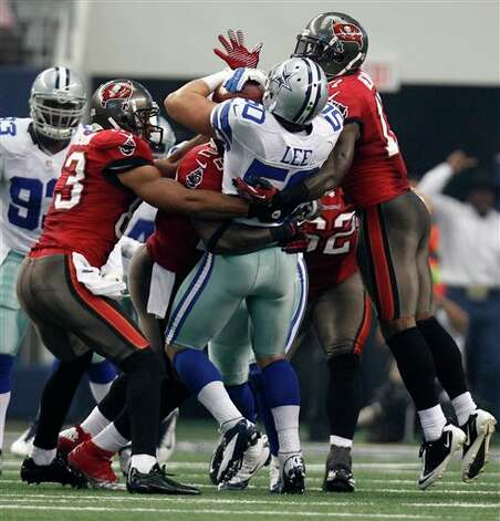 Dallas Cowboys' Sean Lee (50) is tackled by Tampa Bay Buccaneers offensive players after Lee made an interception in the first half of an NFL football game Sunday, Sept. 23, 2012, in Arlington, Texas. (AP Photo/LM Otero) Photo: Associated Press