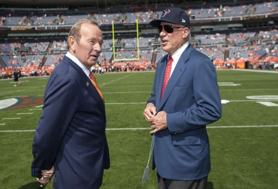 Denver Broncos owner Pat Bolen and Texans owner Bob McNair talk on the field before the game. (Brett Coomer / © 2012  Houston Chronicle)