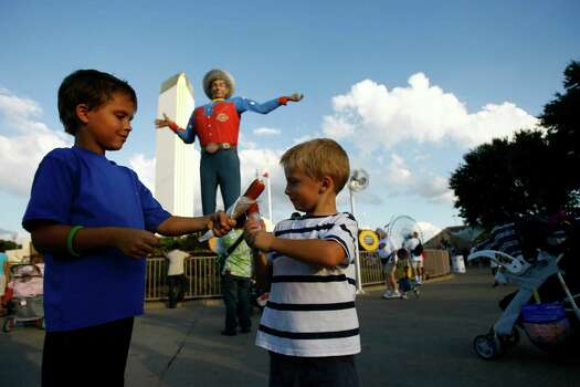 Carson Peters (cq), 7, of Dallas, uses his corndog to play swords with is brother Canon Peters, 4, as they visit Big Tex and the State Fair of Texas  Friday, Oct. 5, 2007, in Dallas. The fair will be opened until Oct. 21, 2007. ( Nick de la Torre / Chronicle ) Photo: Nick De La Torre, Houston Chronicle / Houston Chronicle