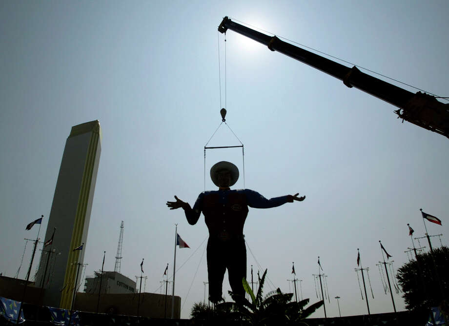 A crane maneuvers Big Tex, a 52-foot-tall talking cowboy figure, into position for the State Fair of Texas, Tuesday, Sept. 27, 2005, in Dallas.  Photo: MATT SLOCUM, AP / AP