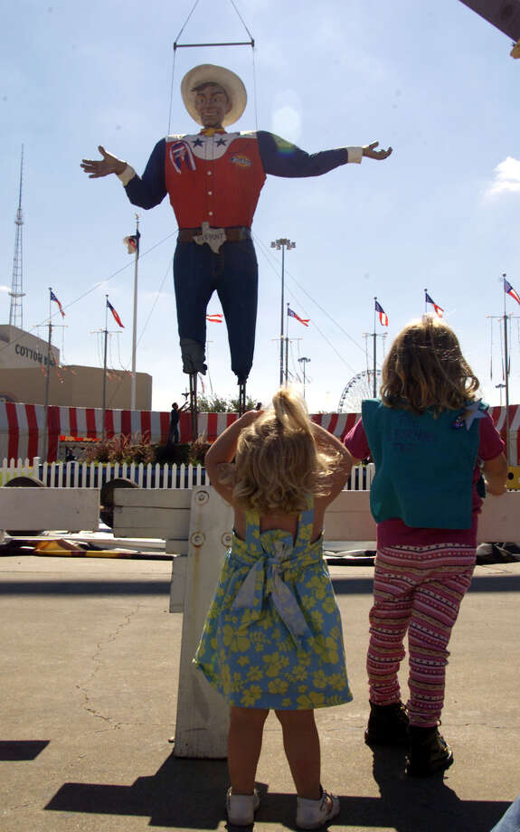 Two-year-old Lauren Bush, left, and four-year-old Carly Jordan,  watch as a crane lifts Big Tex onto his display pad at the State Fair of Texas, in Dallas, Monday, Sept. 24, 2001.  Photo: DONNA MCWILLIAM, AP / AP