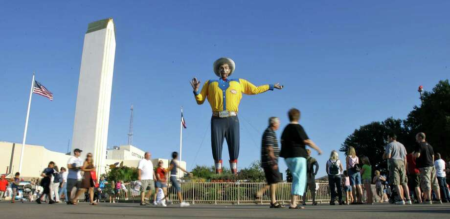 Fair-goers walk past the Big Tex statue during the State Fair of Texas, Tuesday, Sept. 30, 2008, in Dallas. Photo: Matt Slocum, AP / AP