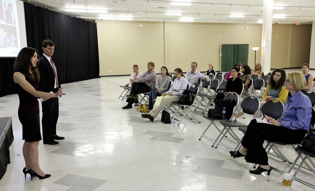 Company spokeswoman Patti Tindall and President Peter Bezanson address San Antonians at a recent public meeting at TriPoint.