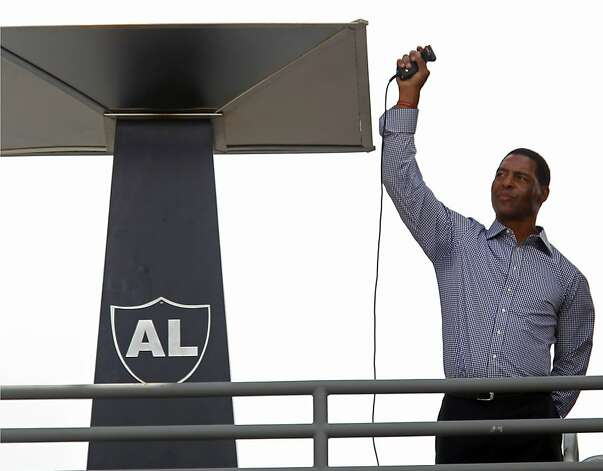 Former Oakland Raiders great Marcus Allen lights the eternal flame for the late Raiders owner Al Davis before an NFL football game between the Raiders and the Pittsburgh Steelers in Oakland, Calif., Sunday, Sept. 23, 2012. (AP Photo/Tony Avelar) Photo: Tony Avelar, Associated Press