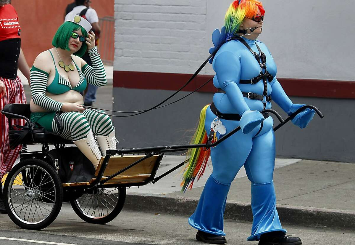 Katy got a ride from her Rainbow blue pony down Folsom Street. The 29th annual Folsom Street Fair in San Francisco, Calif between 7th and 12th Streets attracted thousands of participants and curious spectators to the sometimes outrageous theatre Sunday September 23, 2012.