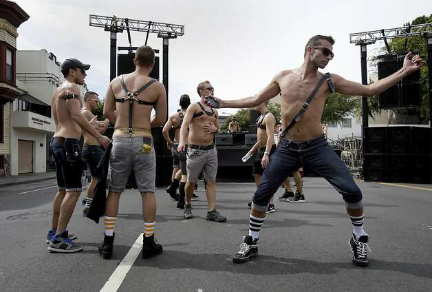 A group of men danced to music at the west side of the fair. The 29th annual Folsom Street Fair in San Francisco, Calif between 7th and 12th Streets attracted thousands of participants and curious spectators to the sometimes outrageous theatre Sunday September 23, 2012. Photo: Brant Ward, The Chronicle