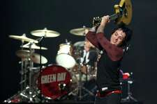 FILE - SEPTEMBER 23: Green Day's Billie Joe Armstrong will enter rehab for substance abuse after a meltdown onstage at the iHeartRadio Music Festival. LAS VEGAS, NV - SEPTEMBER 21:  Frontman Billie Joe Armstrong of Green Day smashes his guitar as he performs onstage during the 2012 iHeartRadio Music Festival at the MGM Grand Garden Arena on September 21, 2012 in Las Vegas, Nevada.