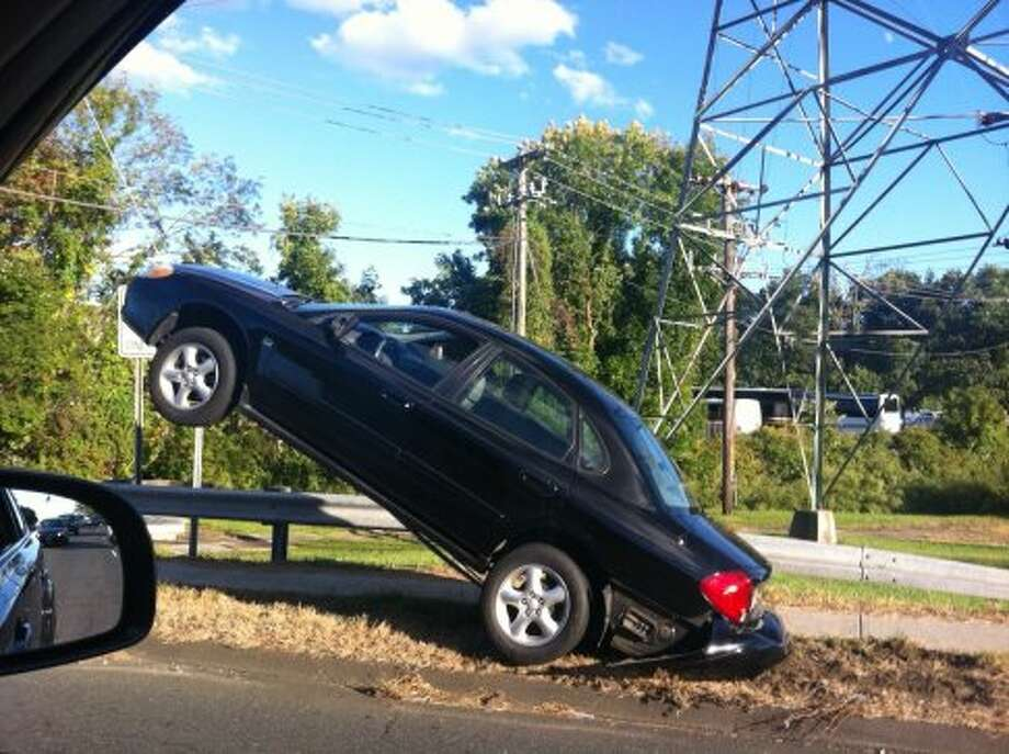 A car climbed up a utility pole Sunday on Connecticut Avenue in Nowalk. There were no injuries. (Brett Mickelson / Brett Mickelson)