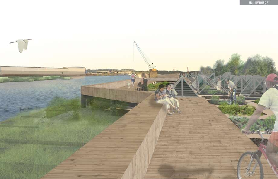 "The winning entry, by David Dahl and Nicole Lew, both of Seattle, was called the ""South Park Food Bridge."" It would use the pontoons to reclaim the Duwamish waterfront in South Park. One set of pontoons would form parks with urban gardens and a boardwalk. The other set would be more porous and devoted to wetlands and creating habitat both above and below the water. Photo: Photos Provided By Sara Strouse"